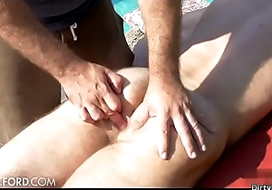 Hairy bodybuilder outdoor together with massage