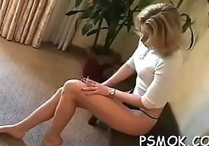 Girl enjoys a cigarette while putting a shlong in her frowardness