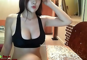 Well-endowed Korean shows the brush huge natural tits