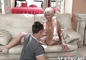 Horny granny enjoys riding and sucking chunky young Hawkshaw