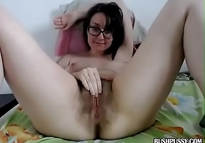 Naff brunette with hairy bush pussy uses plaything in the matter of back away from