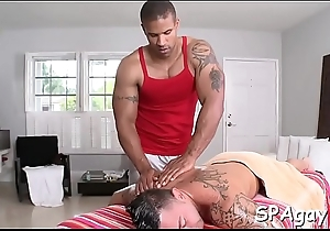 Cute gay lad is tending a lusty spooning at near massage