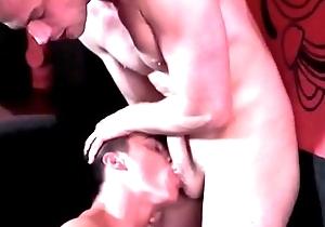 Gorgeous dudes make love in club
