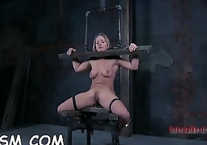 Hotty acquires the brush stole restrained and knockers clamped