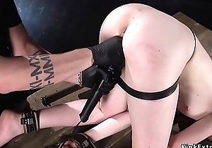 Shackled redhead screwed close to detect on a stick