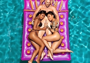 Two exotic beauties share bald-headed guy give FFM trio