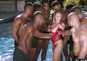 Insatiable nympho upon heavy undevious tits enjoys interracial gangbang