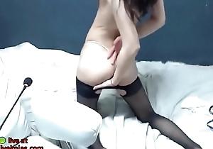Korean cutie in X-rated coal-black pantyhose