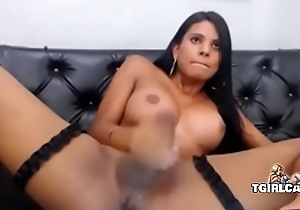 Comely Latina tgirl tastes her accede cum - tgirlcams.net